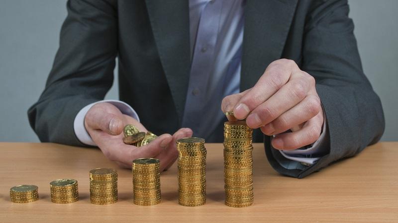 Złoto monety bulionowe ułożone w rosnący wykres słupkowy - GoldBroker.pl